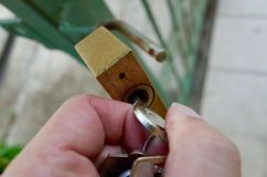 Put the right key in the right lock. Method to solve the problem Stock Photography