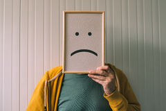 Put a sad pessimisic face on, sadness and depressive emotions co Stock Images