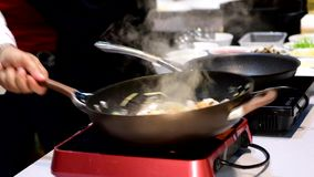 Put Sauce in Pad thai on pan. Put Sauce in Pad thai Fried noodle Thai style with prawns on pan stock video footage