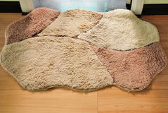 The door mat. Put in the sitting room the door mat. Waterproof, dustproof Stock Photo