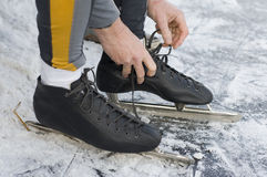 Put on the skates. At the ice Stock Image