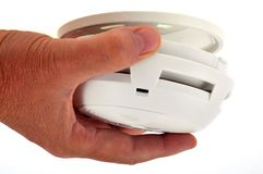 Put a smoke detector in close-up stock photo