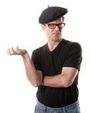 Put Something In His Hand. Man in beret holding nothing on a white background royalty free stock photography