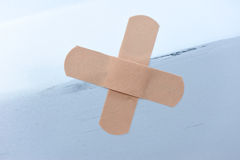 Put sticking plaster at car scratches Stock Image