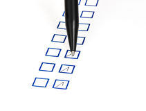 Put tick in blue square box. By black ballpoint Royalty Free Stock Photos
