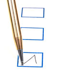 Put tick in blue square box. By metal gold ballpoint pen Stock Photos