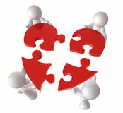 Put together a heart puzzle pieces Stock Images