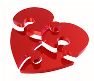 Put together a heart puzzle pieces Stock Photo