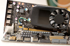 Put video card to motherboard Stock Photo