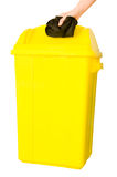 Put waste into yellow bin. Isolated on white background, clipping path Royalty Free Stock Photo