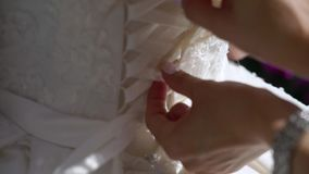 Put on wedding dress. Put on wedding bridal dress stock video