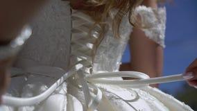 Put on wedding dress. Put on wedding bridal dress stock footage