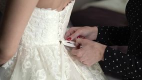 Put on wedding dress. Tie stock video