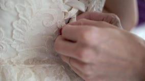 Put on wedding dress. Tie stock video footage