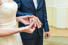 He Put the Wedding Ring on Her Stock Photos