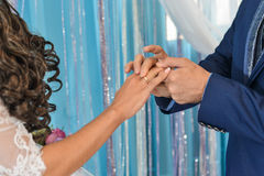 He Put the Wedding Ring on Her Stock Image