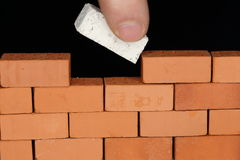 Put a white brick. In the wall Royalty Free Stock Photos