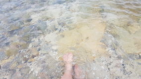 Put your feet in the cold water. Clear water in thailand Royalty Free Stock Photography