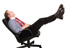 Put your feet up. Businessman leaning back to relax a bit - isolated on white and retouched Stock Photo