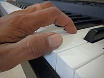 Put your finger on the piano to practice. stock photo