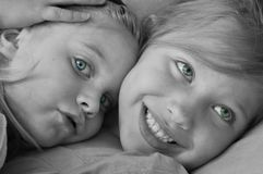 Put Your Head On My Shoulder. Selective colored closeup portrait of sisterly love Royalty Free Stock Photo