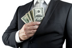 Put your money in the pocket. A well-dressed man put money in the jacket Royalty Free Stock Image