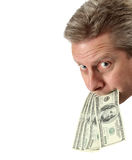 Put Your Money Where Your Mouth Is. A man puts his money where his mouth is on white royalty free stock images