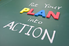 Put your plan into action. Words on blackboard Stock Image