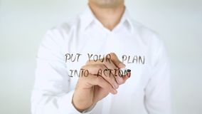Put Your Plan into Action, Man Writing on Glass Stock Image