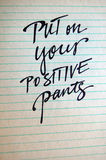 Put on Your Positive Pants calligraphic background Stock Image