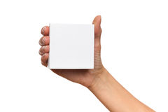 Put Your Product Name On This Box. Close up of woman's hand holding white carton box. Studio shot isolated on white Royalty Free Stock Photography