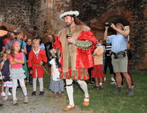 Puta in renaissance clothes. Actor in noble renaissance costume playing owner of castle Puta in front of spectators and cameraman during Night performance Stock Images