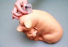 Puting euro money into coin box Royalty Free Stock Photos