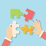 Puting puzzle pieces. Royalty Free Stock Photo