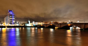Putney Bridge at night, seen from across the River Thames in London, at night stock photo