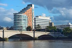 Putney Bridge, River Thames, London, UK. Putney Bridge, on the River Thames, London, UK, Europe, overshadowed by St Mary's Church, itself dominated by tower royalty free stock photo