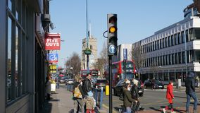 Putney High Street on a Busy Sunday Morning. Putney is a district in south-west London, England in the London Borough of Wandsworth.Putney is an ancient parish Stock Images