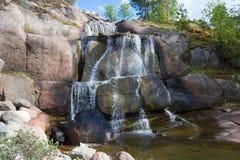 Putouskallio rock with an artificial waterfall in Sapokka Water Garden. Kotka, Finland Stock Photography