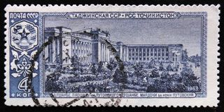 Putovsky square in Dushanbe - the capital of Tajikistan, circa 1958. MOSCOW, RUSSIA - APRIL 2, 2017: A post stamp printed in USSR shows view of Putovsky square Stock Photo