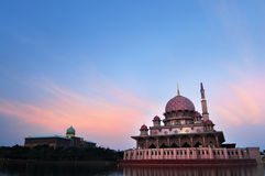 The Putra Mosque. Putra Mosque is the principal mosque of Putrajaya, Malaysia. Building on the left is Perdana Putra which is Malaysian Prime Minister's office Stock Photos