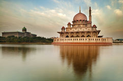 The Putra Mosque. Putra Mosque is the principal mosque of Putrajaya, Malaysia. Building on the left is Perdana Putra which is Malaysian Prime Minister's office Stock Image