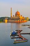 The putra mosque by the lake side. The Putra mosque in Putrajaya , Malaysia during sunset Royalty Free Stock Image