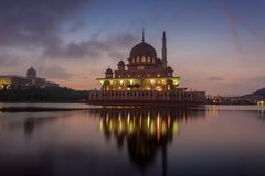 Putra Mosque from the lakeside view. Royalty Free Stock Images