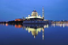 Putra Mosque. The Putra Mosque is the principal mosque of Putrajaya, Malaysia. Construction of the mosque began in 1997 and was completed two years later. It is stock photo