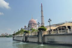Putra Mosque. The Putra Mosque is the principal mosque of Putrajaya, Malaysia. Construction of the mosque began in 1997 and was completed two years later. It is royalty free stock photo