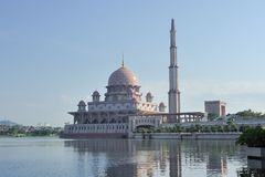 Putra Mosque. The Putra Mosque is the principal mosque of Putrajaya, Malaysia. Construction of the mosque began in 1997 and was completed two years later. It is stock images
