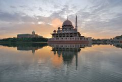 Putra Mosque. The Putra Mosque is the principal mosque of Putrajaya, Malaysia. Construction of the mosque began in 1997 and was completed two years later. It is royalty free stock image