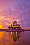 Putra Mosque and Reflection. Potrait orientation of the Putra Mosque in Putrajaya, Malaysia in a beautiful sunrise with reflection in the lake Stock Photo