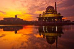 Putra Mosque and Sunrise. Putra Mosque in Putrajaya Malaysia at sunrise with the Prime Ministers Office building in the background Royalty Free Stock Photos