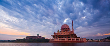 Putra Mosque and Sunrise. Panoramic morning view Putra Mosque in Putrajaya Malaysia with the Prime Ministers Office building in the background Stock Images